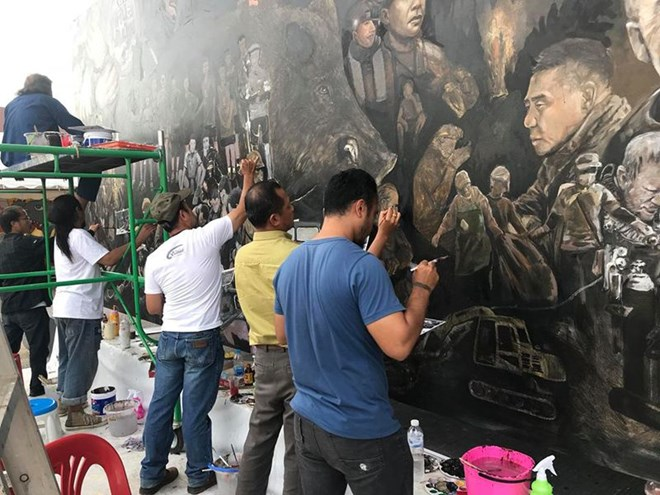 Thai artists create artwork telling tham luang rescue for Artiste creation